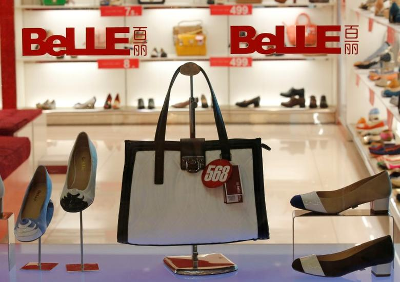 Products of Belle are seen at a show window at its store in Beijing March 25, 2013.  REUTERS/Kim Kyung-Hoon/File Photo