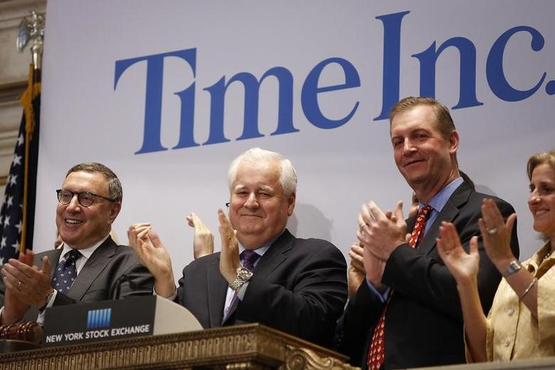 Time Inc. CEO Joe Ripp (2nd L) claps after ringing the bell to open trading at the New York Stock Exchange in New York June 9, 2014. REUTERS/Carlo Allegri/Files