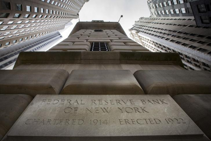 The corner stone of The New York Federal Reserve Bank is seen surrounded by financial institutions in New York's financial district March 25, 2015.  REUTERS/Brendan McDermid/File Photo