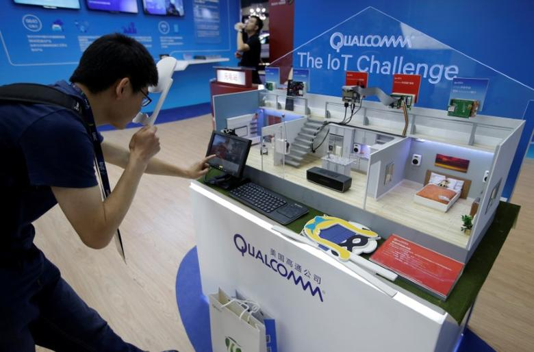 FILE PHOTO: A man visits Qualcomm's booth at the Global Mobile Internet Conference (GMIC) 2017 in Beijing, China April 28, 2017. REUTERS/Jason Lee