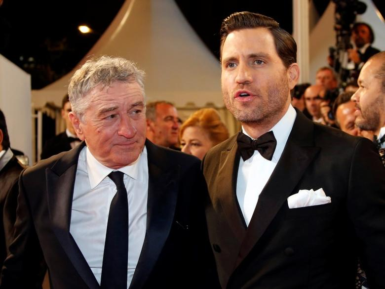 Cast members Robert De Niro and Edgar Ramirez pose on the red carpet as they arrive for the screening of the film ''Hands of Stone'' out of competition at the 69th Cannes Film Festival in Cannes, France, May 16, 2016. REUTERS/Jean-Paul Pelissier