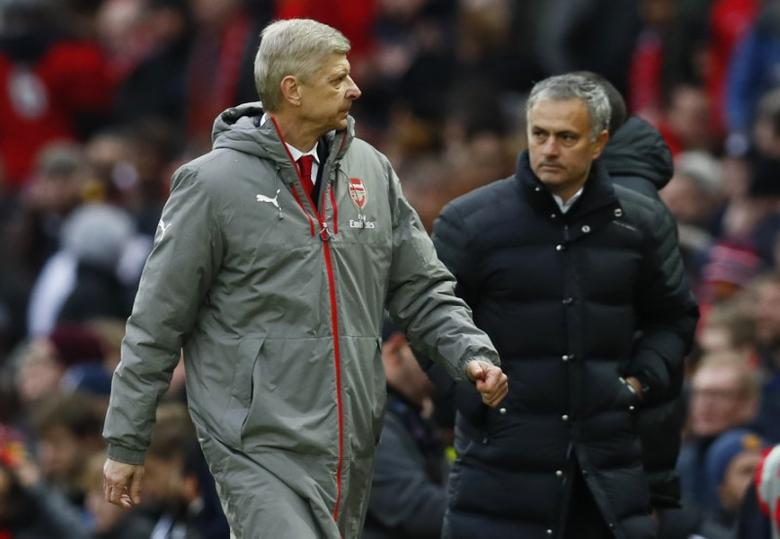 Britain Football Soccer - Manchester United v Arsenal - Premier League - Old Trafford - 19/11/16 Arsenal manager Arsene Wenger and Manchester United manager Jose Mourinho at the end of the match Action Images via Reuters / Jason Cairnduff Livepic