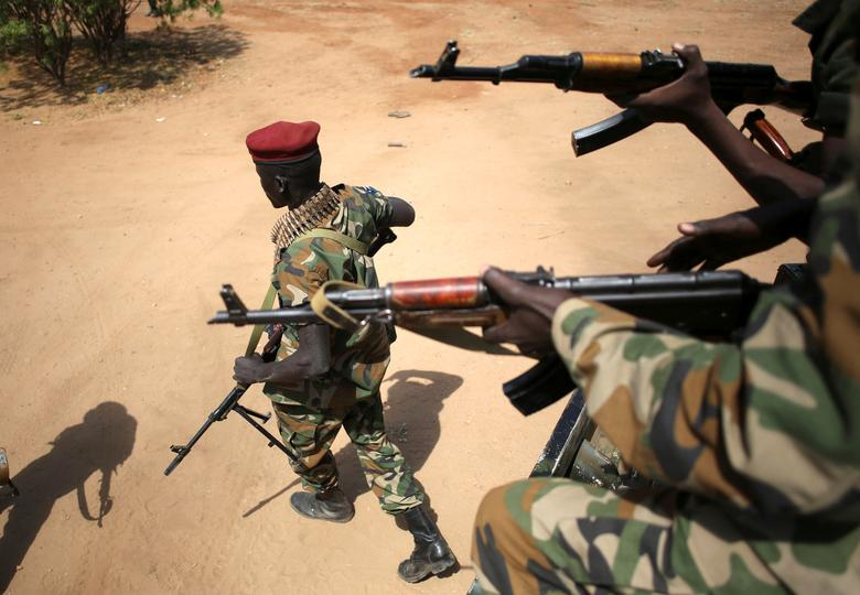 FILE PHOTO - An SPLA soldier walks away from a vehicle in Juba, South Sudan, December 21, 2013. Picture taken December 21, 2013.   REUTERS/Goran Tomasevic/File Photo