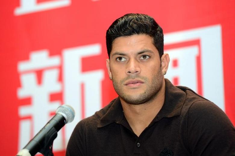 Chinese Super League club Shanghai SIPG's new signing, Brazilian forward Hulk, attends a news conference in Shanghai, China, July 1, 2016. REUTERS/Stringer/File Photo