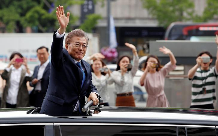 South Korean President Moon Jae-in waves as he heads for the Presidential Blue House in Seoul, South Korea, May 10, 2017.  Yonhap via REUTERS