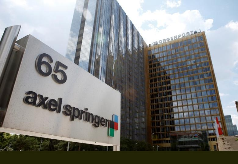 FILE PHOTO: The logo of German publisher Axel Springer is pictured in front of the company's headquarters in Berlin July 25, 2013.  REUTERS/Fabrizio Bensch/File Photo