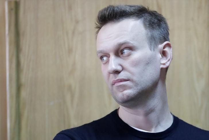Russian opposition leader Alexei Navalny attends a hearing after being detained at the protest against corruption and demanding the resignation of Prime Minister Dmitry Medvedev, at the Tverskoi court in Moscow, Russia March 27, 2017.  REUTERS/Tatyana Makeyeva/Files