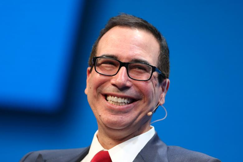 FILE PHOTO: Steven Mnuchin, U.S. Treasury Secretary, laughs during the Milken Institute Global Conference in Beverly Hills, California, U.S., May 1, 2017. REUTERS/Lucy Nicholson/File Photo