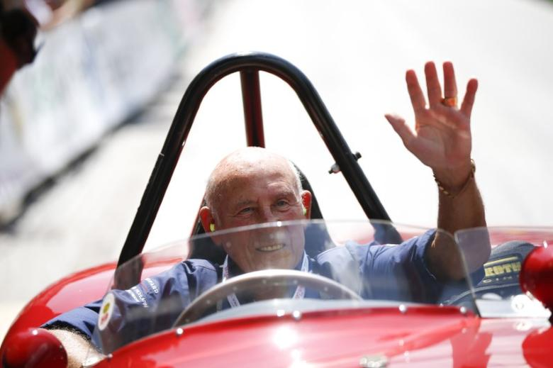 Former English Formula One driver Stirling Moss waves to spectators as he sits in his 1955 Ferrari 750 Monza during the Ennstal Classic rally near the Austrian village of Groebming July 20, 2013. REUTERS/Leonhard Foeger/Files