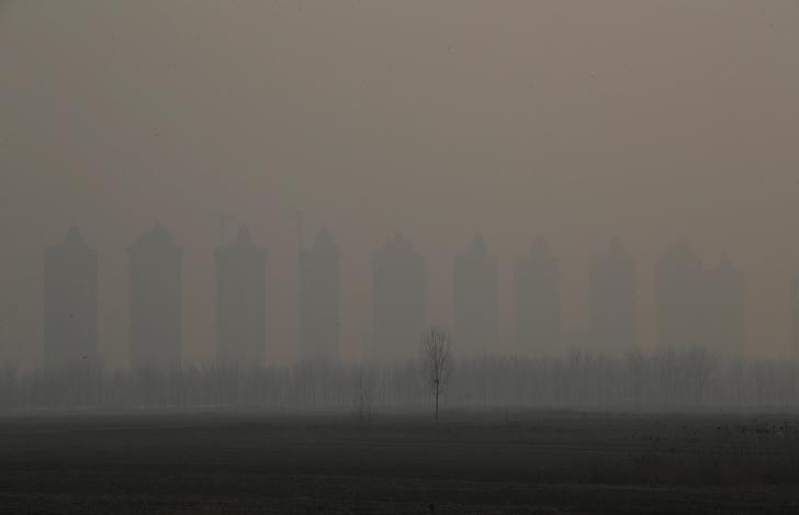 Residential buildings under construction are pictured on a polluted day after the Chinese Lunar New Year holidays on the outskirts of Langfang, Hebei province, China, February 3, 2017. REUTERS/Jason Lee
