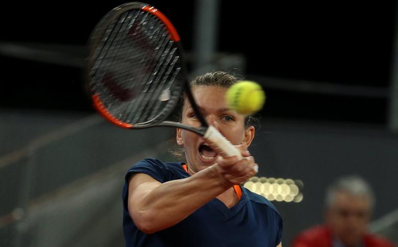 Tennis - WTA - Madrid Open - Simona Halep of Romania v Anastasija Sevastova of Latvia - Madrid, Spain - 12/5/17- Halep returns a forehand during Women's Singles Semifinal match. REUTERS/Sergio Perez