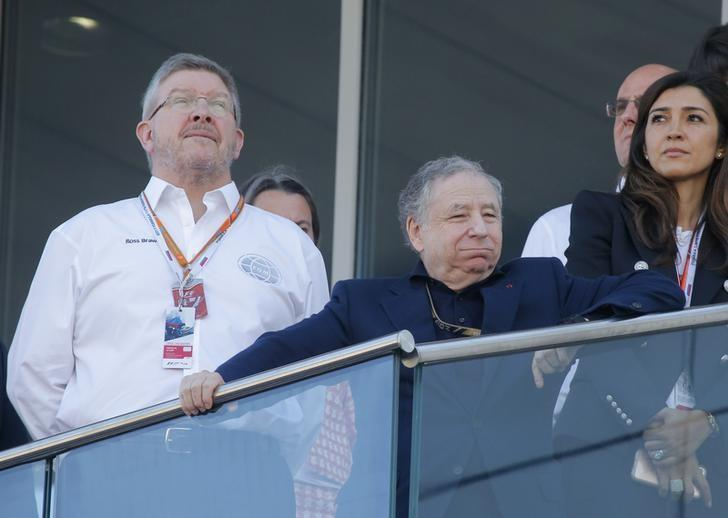 Formula One - F1 - Russian Grand Prix - Sochi, Russia - 30/04/17 - FIA President Jean Todt (2nd L) and Formula One Managing Director of Motorsports Ross Brawn (L) gather after the race. REUTERS/Maxim Shemetov