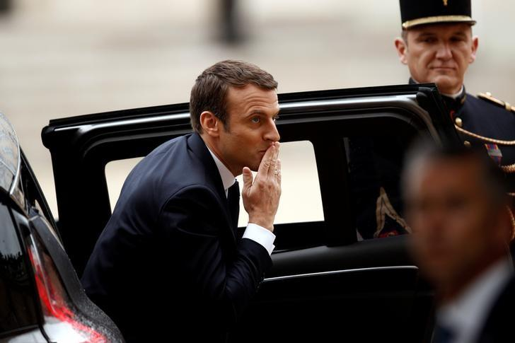 French President-elect Emmanuel Macron reacts as he arrives to attend a handover ceremony with outgoing President Francois Hollande at the Elysee Palace in Paris, France, May 14, 2017.  REUTERS/Yoan Valat/Pool