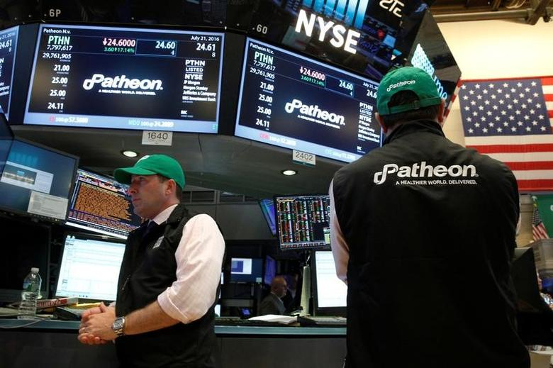 Traders work at the post where shares of Patheon NV is traded on the floor of the New York Stock Exchange (NYSE) in New York City, U.S., July 21, 2016.  REUTERS/Brendan McDermid