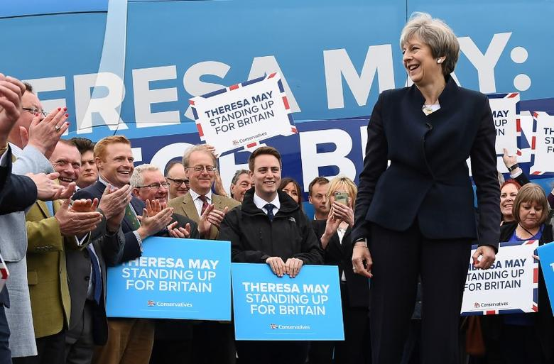 Britain's Prime Minister Theresa May addresses supporters and members of the media in front of the Conservative party's election campaign bus at an airfield north of Newcastle, England May 12, 2017. REUTERS/Justin Tallis/Pool