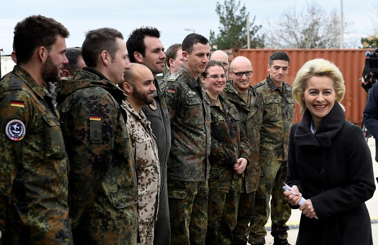 German Defence Minister Ursula von der Leyen chats with soldiers during a visit of the German Armed Forces Bundeswehr at the air base in Incirlik, Turkey, January 21, 2016. REUTERS/Tobias Schwarz/Pool/File Photo
