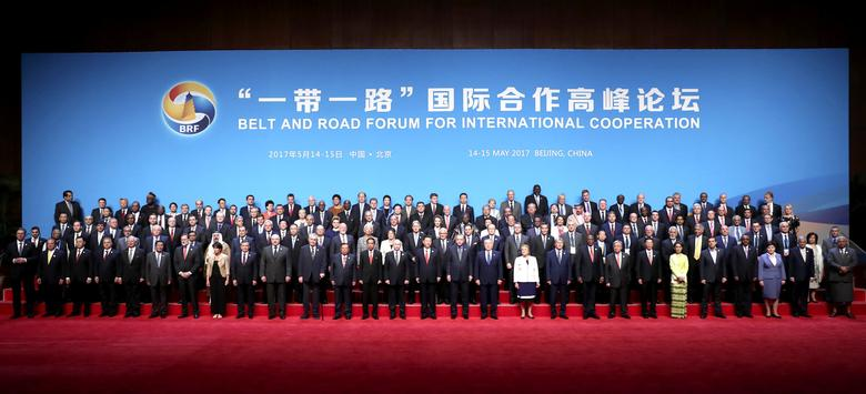 Chinese President Xi Jinping and delegates attending the Belt and Road Forum pose for a group photo in Beijing, China May 14, 2017. Courtesy of Xinhua/Pang Xinglei/Handout via REUTERS