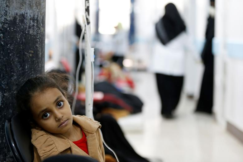 A girl infected with cholera sits on a chair at a hospital in Sanaa. REUTERS/Khaled Abdullah