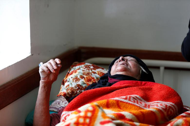 A cholera-infected woman lies on a hospital bed in Sanaa. REUTERS/Khaled Abdullah
