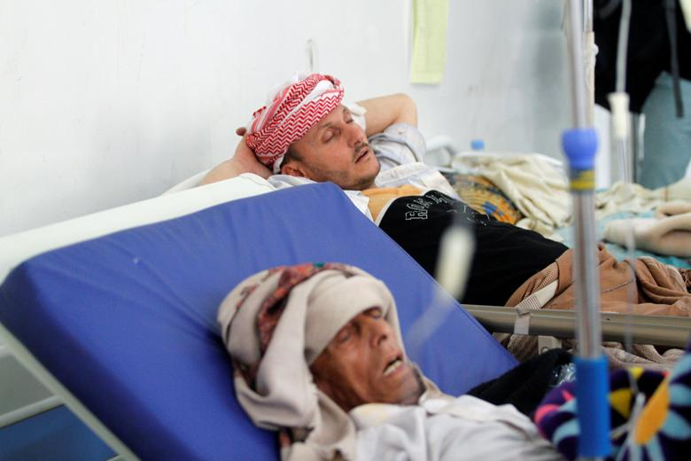 Men with cholera infected lie on beds at a hospital in Sanaa. REUTERS/Mohamed al-Sayaghi