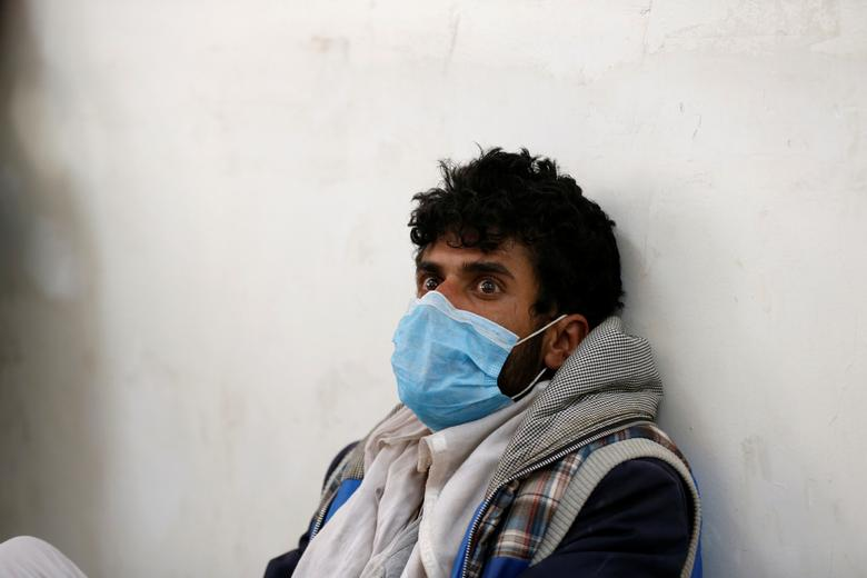 A man sits as he waits for a cholera-infected relative at a hospital in Sanaa. REUTERS/Khaled Abdullah
