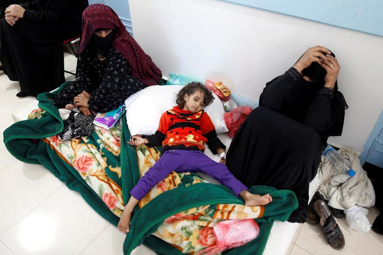 A girl infected with cholera lies on the ground at a hospital in Sanaa. REUTERS/Khaled Abdullah