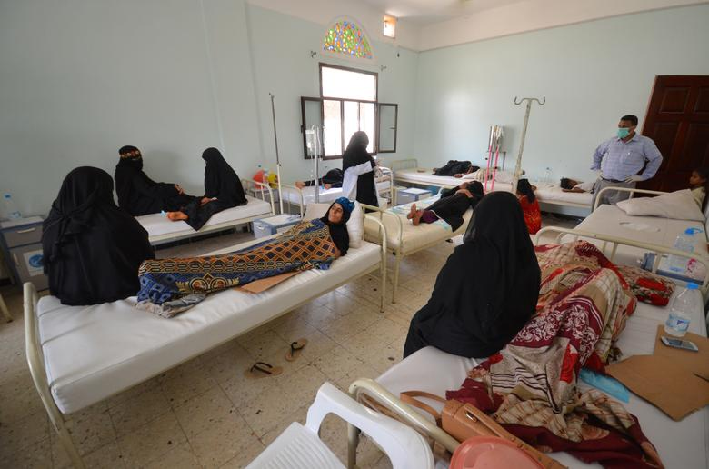 Women sit with relatives infected with cholera at a hospital in the Red Sea port city of Hodeidah. REUTERS/Abduljabbar Zeyad