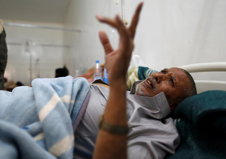 A cholera-infected man reacts as he lies on a hospital bed in Sanaa. REUTERS/Khaled Abdullah