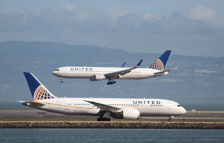 FILE PHOTO: A United Airlines aircraft taxis as another lands at San Francisco International Airport, San Francisco, California, U.S., February 7, 2015. REUTERS/Louis Nastro/File Photo