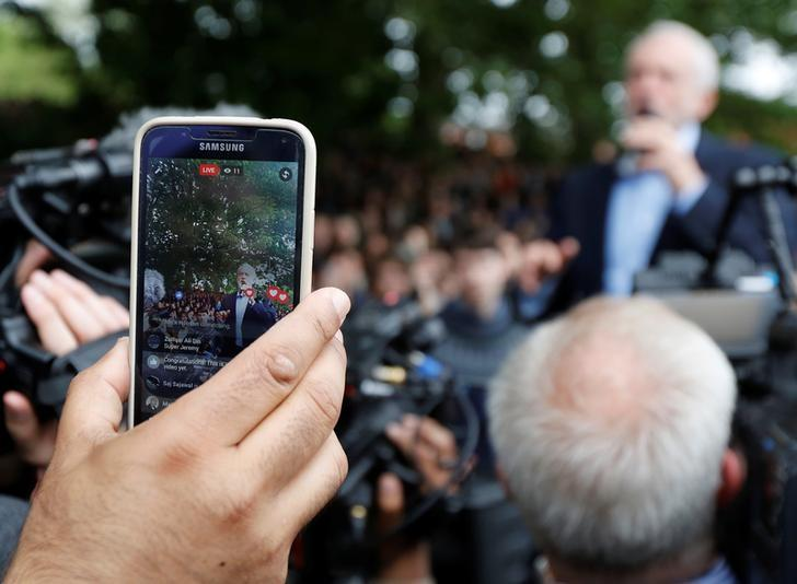 A man films Jeremy Corbyn, the leader of Britain's opposition Labour Party,  on his mobile phone as he speaks at a campaign event in Leeds, May 15, 2017. REUTERS/Darren Staples