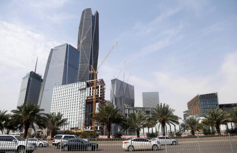 FILE PHOTO: Cars drive past the King Abdullah Financial District, north of Riyadh, Saudi Arabia, March 1, 2017. REUTERS/Faisal Al Nasser/File Photo