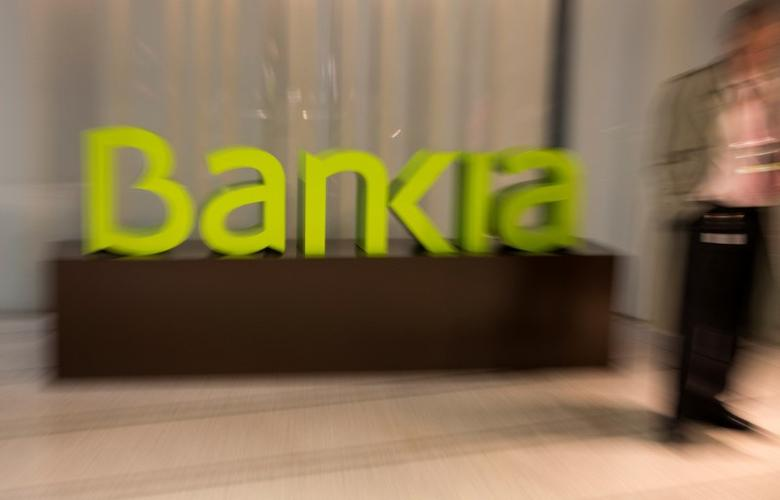 FILE PHOTO: Spain's Bankia logo is seen inside bank's headquarters before a news conference to present their annual results in Madrid, Spain, January 30, 2017. REUTERS/Sergio Perez -/File Photo