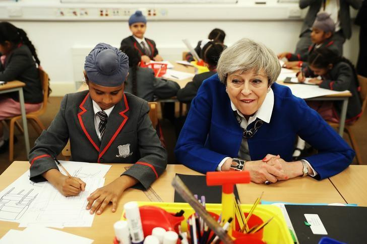 Britain's Prime Minister Theresa May meets the Nishkam Trust leadership team and pupils of Nishkam Primary School in Birmingham, May 16, 2017. REUTERS/ Dan Kitwood/Pool