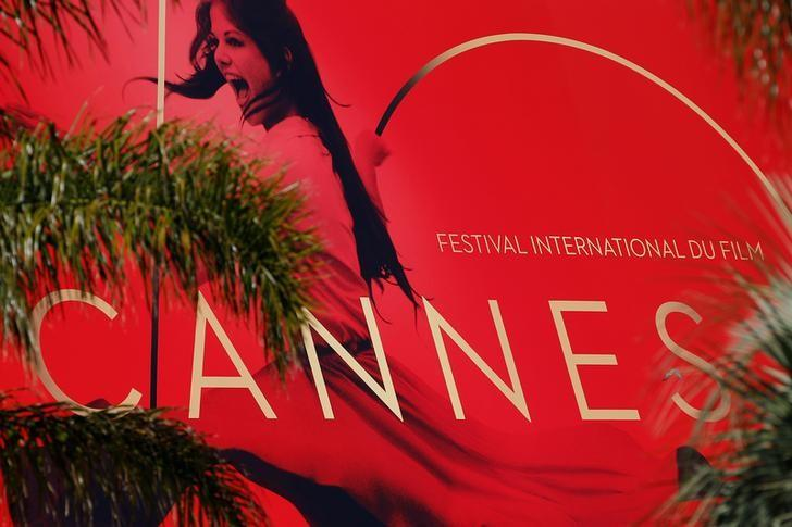 70th Cannes Film Festival - Cannes, France. 16/05/2017 - The official poster, featuring actress Claudia Cardinale, is seen on the facade of the festival palace. REUTERS/Stephane Mahe