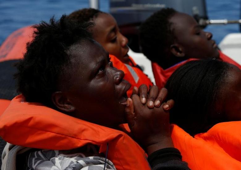 A migrant reacts after being rescued by the Malta-based NGO Migrant Offshore Aid Station (MOAS) ship Phoenix during a rescue operation in the central Mediterranean in international waters, off the Libyan coastal town of Sabratha, May 4, 2017.    REUTERS/Darrin Zammit Lupi