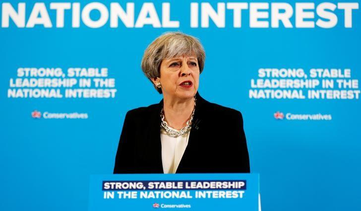 Britain's Prime Minister Theresa May answers a question during a news conference with Chancellor of the Exchequer Philip Hammond in London's Canary Wharf financial district, May 17, 2017. REUTERS/Stefan Wermuth
