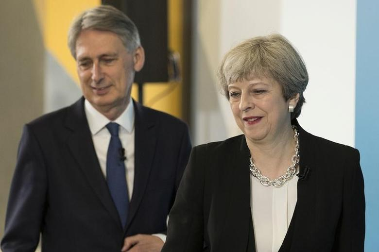 Britain's Prime Minister Theresa May and Chancellor of the Exchequer Philip Hammond attend a news conference in London's Canary Wharf financial district, May 17, 2017. REUTERS/Dan Kitwood/Pool