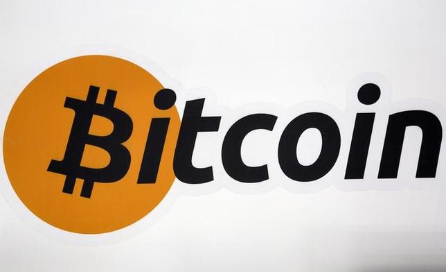 FILE PHOTO: A Bitcoin logo is displayed at the Bitcoin Center New York City in New York's financial district, U.S. on July 28, 2015. REUTERS/Brendan McDermid/File Photo
