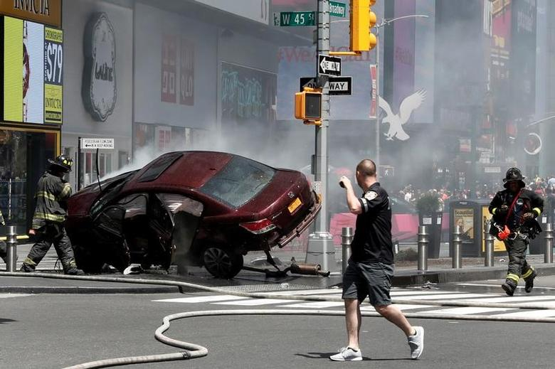 A vehicle that struck pedestrians and later crashed is seen on the sidewalk in Times Square in New York City, U.S., May 18, 2017. REUTERS/Mike Segar