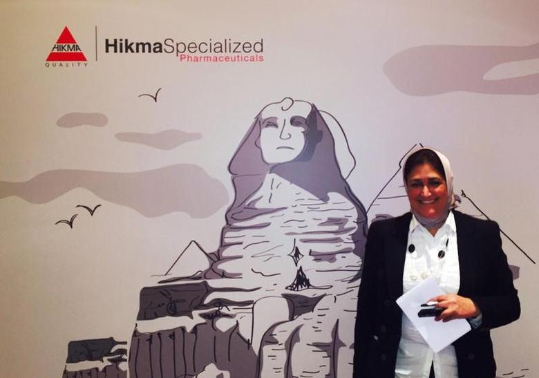 An employee worker is seen in front of the banner and logo of Hikma Pharmaceuticals at their conference outrisk of Cairo, Egypt, June 2, 2016. REUTERS/Ehab Farouk