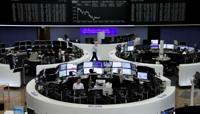 Traders work in front of the German share price index, DAX board, at the stock exchange in Frankfurt, Germany, May 18, 2017. REUTERS/Staff/Remote