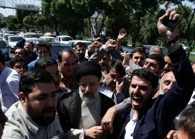 Iranian presidential candidate Ebrahim Raisi (C) arrives with crowds of supporters to cast his vote during the presidential election in Tehran, Iran, May 19, 2017. TIMA via REUTERS