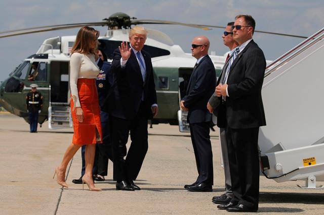 U.S. President Donald Trump and first lady Melania Trump board Air Force One for his first international trip as president, including stops in Saudi Arabia, Israel, the Vatican, Brussels and at the G7 summit in Sicily, from Joint Base Andrews, Maryland, U.S. May 19, 2017. REUTERS/Jonathan Ernst