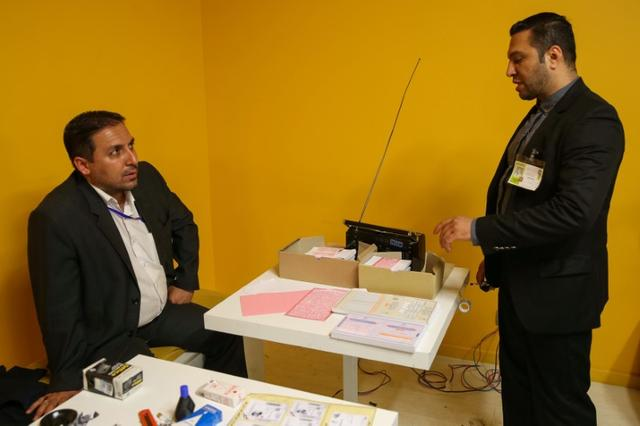 Electoral employees prepare to close voting for the presidential election in a polling station in Tehran, Iran, May 19, 2017. TIMA via REUTERS