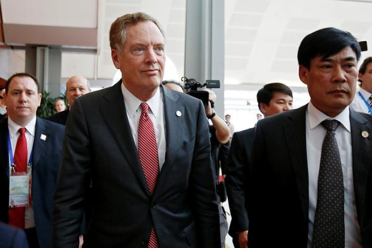 U.S. Trade Representative Robert Lighthizer (C) leaves a press conference during the APEC Ministers Responsible For Trade (APEC MRT 23) meeting in Hanoi, Vietnam May 21, 2017. REUTERS/Kham
