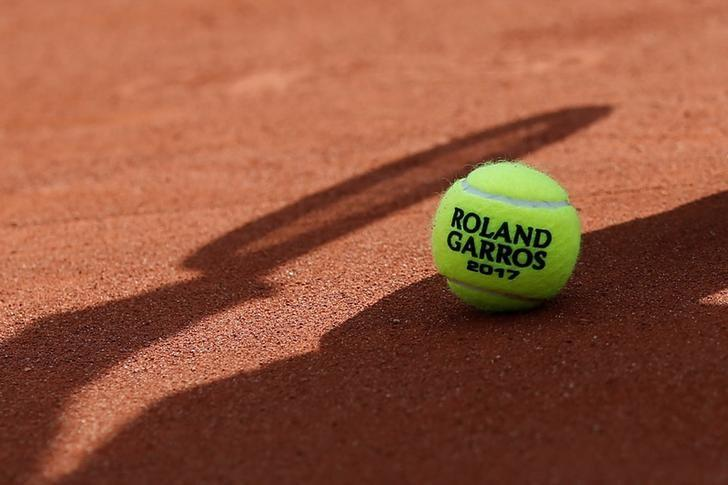 A Roland Garros 2017 tennis ball is seen at the Stade Roland Garros tennis venue complex, where the French Open is held, during a visit by the the International Olympic Committee Evaluation Commission, in Paris, France, May 15, 2017. REUTERS/Gonzalo Fuentes/Files