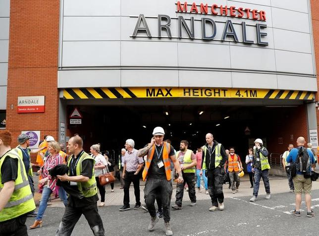 People rush out of the Arndale shopping centre as it is evacuated in Manchester, Britain May 23, 2017. REUTERS/Darren Staples