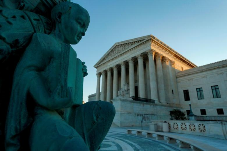 FILE PHOTO: A figure of a child holding an open book decorates a flagpole at the U.S. Supreme Court building in Washington, U.S., October 5, 2014. REUTERS/Jonathan Ernst/File Photo