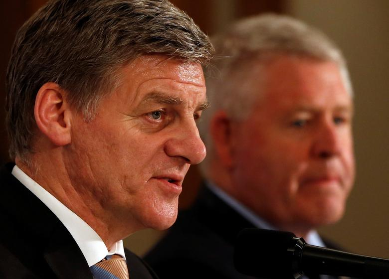 FILE PHOTO: New Zealand Prime Minister Bill English (L) and New Zealand Rugby Union CEO Steve Tew attend a joint news conference with Japan Rugby Football Union President Tadashi Okamura (not pictured) in Tokyo, Japan May 17, 2017. REUTERS/Issei Kato