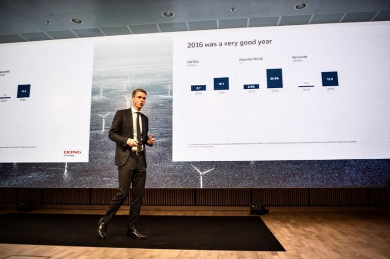 FILE PHOTO: Danish company DONG Energy CEO Henrik Poulsen presents the company's strategy during a news conference at headquarters in Gentofte, north of Copenhagen, Denmark February 2, 2017.  Scanpix Denmark/Ida Guldbaek Arentsen via REUTERS